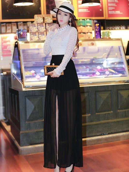 ชุดเดรสยาวสวยๆ เสื้อลูกไม้สีขาวแขนยาวเย็บติดกับกระโปรงยาวสีดำ
