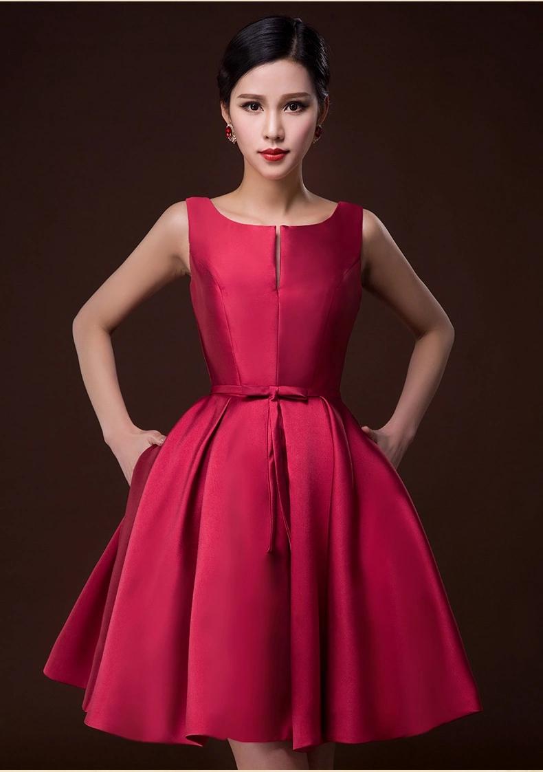 ชุดเดรสออกงานสีแดงเข้ม ผ้าไหมอิตาลี แขนกุด กระโปรงทรงทวิส แต่งโบว์ด้านหน้า เรียบหรู ดูดี