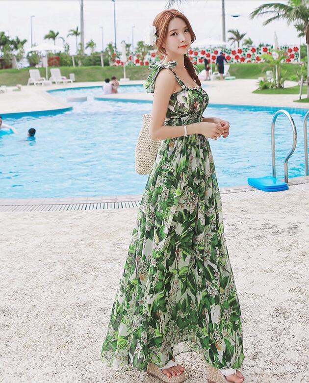ชุดไปเที่ยวทะเล เดรสยาวโทนสีเขียว ลายดอกไม้ สวยๆ สวมใส่สบายๆ